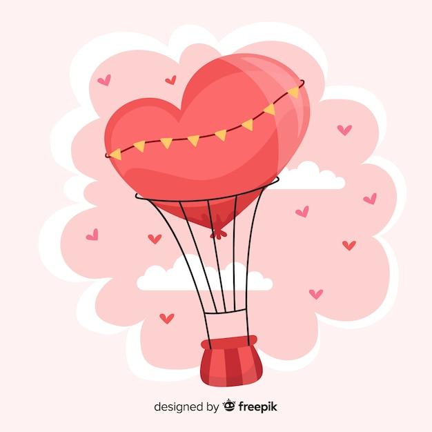 Fondo disegnato a mano del cuore della mongolfiera Vettore gratuito