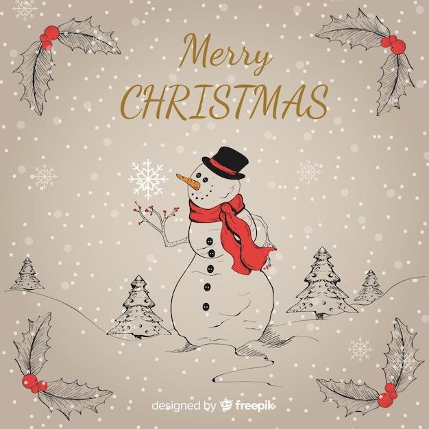 Fondo disegnato a mano del pupazzo di neve di natale Vettore gratuito
