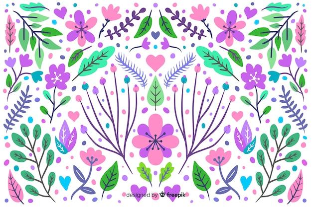 Fondo floreale di colore pastello disegnato a mano Vettore gratuito