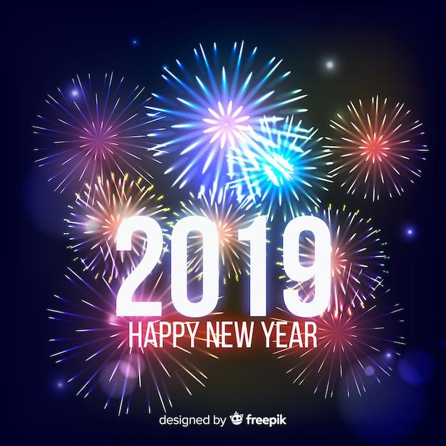 Fondo realistico dei fuochi d'artificio del nuovo anno Vettore gratuito