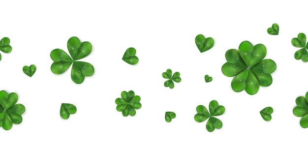 Fondo senza cuciture orizzontale del giorno di happy st. patrick con l'acetosella, trifoglio di quattro foglie isolato su fondo bianco. modello di simbolo dell'irlanda. Vettore Premium