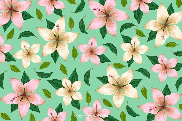 Fondo tropicale piano del modello di fiore Vettore gratuito