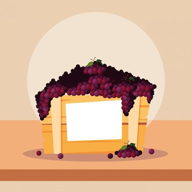 Frutti freschi dell'uva in cassa di legno Vettore Premium