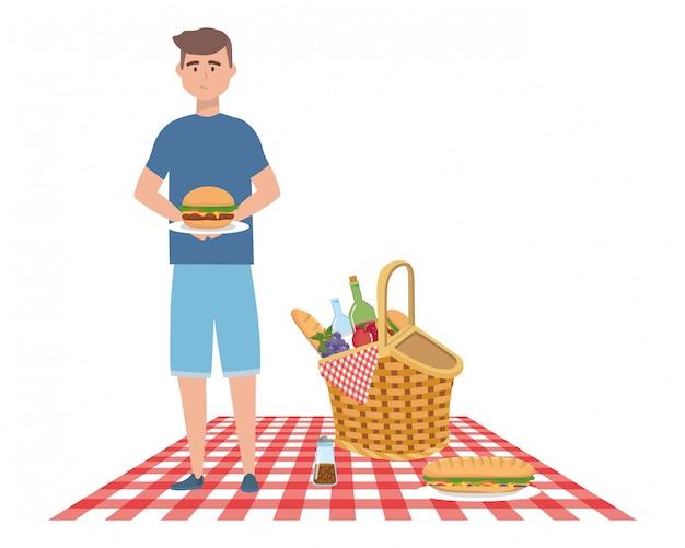 Fumetto dell'uomo che ha picnic Vettore Premium