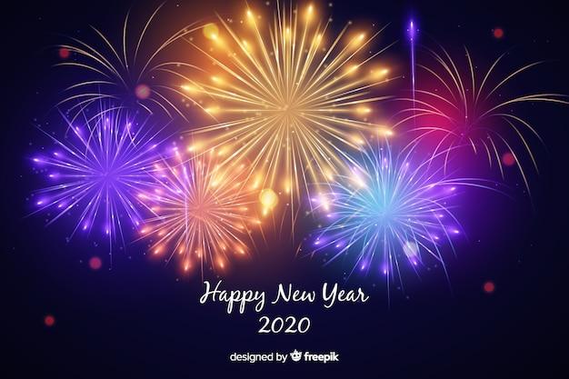 Fuochi d'artificio colorati del nuovo anno 2020 Vettore gratuito