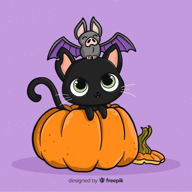 Gatto di halloween disegnato a mano adorabile Vettore gratuito