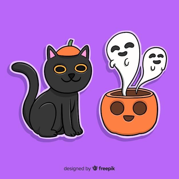 Gatto e zucca di halloween disegnati a mano con i fantasmi Vettore gratuito