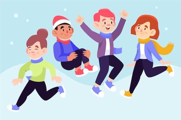 Gente felice che indossa abiti invernali saltando Vettore gratuito