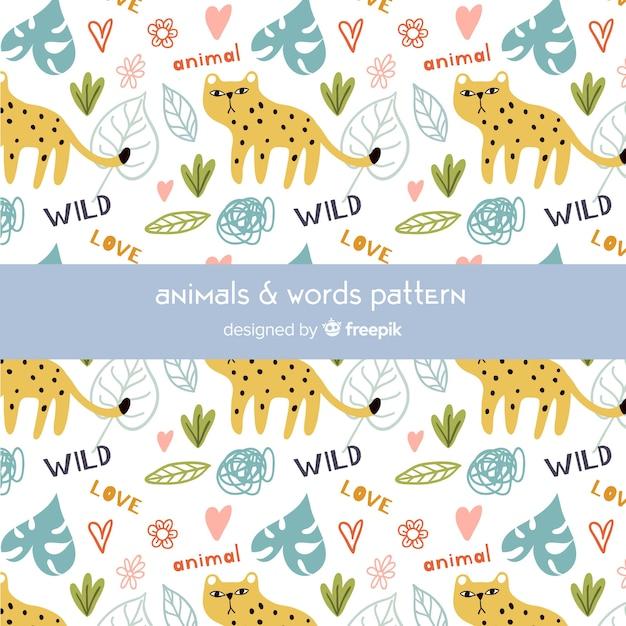 Ghepardo doodle colorato e pattern di parole Vettore gratuito