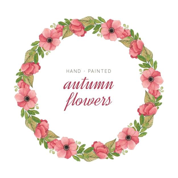 Ghirlanda dipinta a mano con foglie e fiori ad acquerelli Vettore Premium