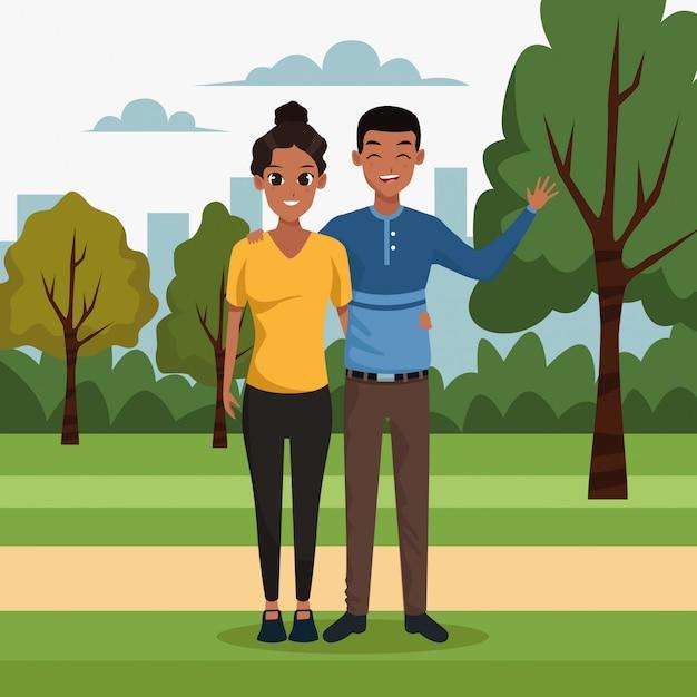 Giovane coppia nello scenario del parco Vettore gratuito