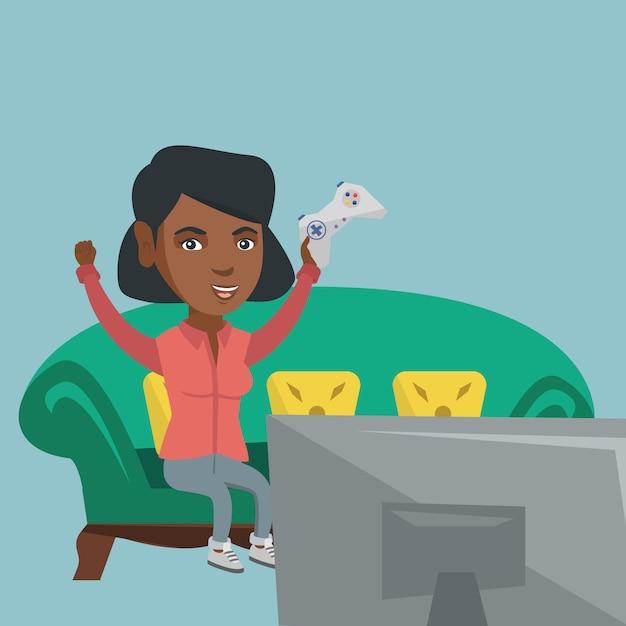 Giovane donna afroamericana che gioca video gioco. Vettore Premium