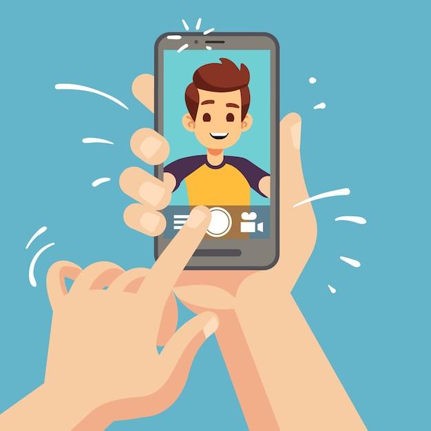 Giovane uomo felice che prende la foto del selfie sullo smartphone. ritratto del volto maschile sullo schermo del cellulare. illustrazione di cartone animato Vettore Premium