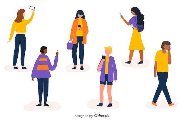 Giovani che tengono i loro smartphone impostati Vettore gratuito