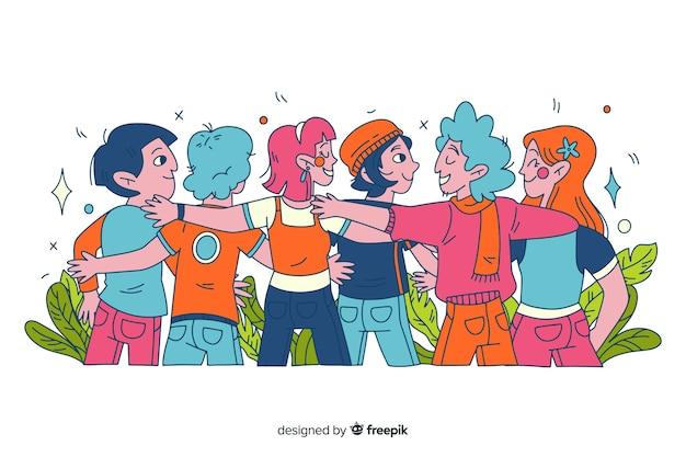 Giovani disegnati a mano che abbracciano insieme Vettore gratuito