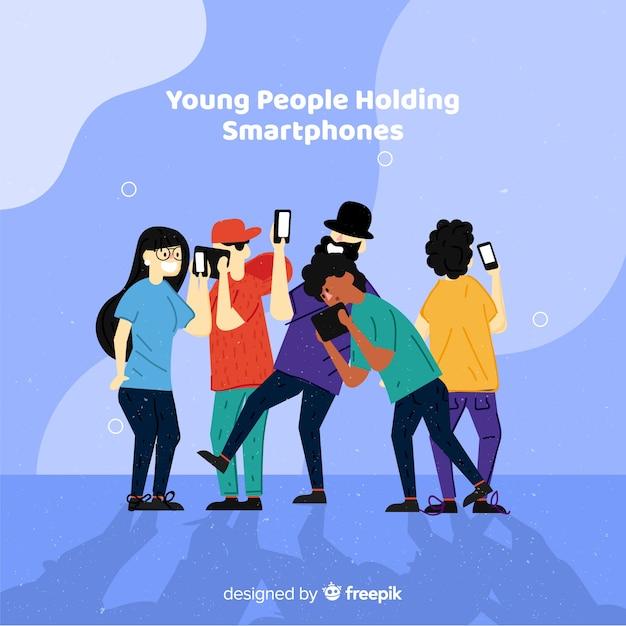 Giovani disegnati a mano utilizzando set di smartphone Vettore gratuito