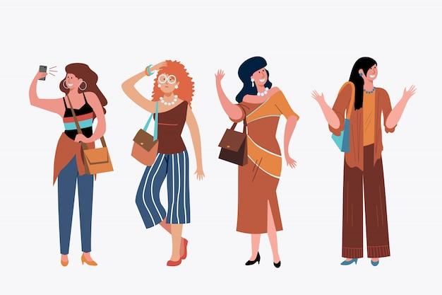 Giovani donne alla moda fuori set Vettore gratuito