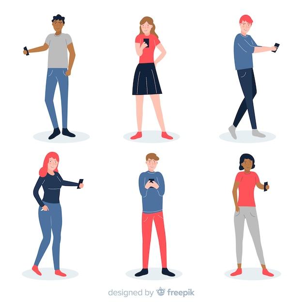 Giovani in possesso di smartphone Vettore gratuito