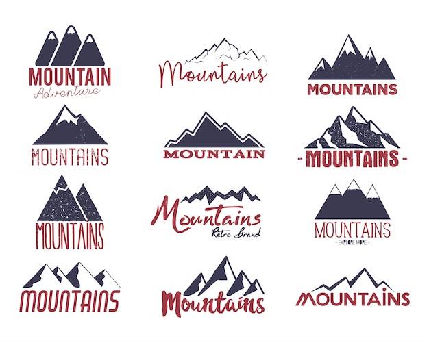 Gli emblemi del logos della montagna hanno messo le insegne Vettore Premium