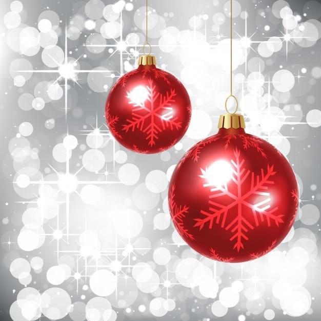 Glitter sfondo argento con palline rosse Vettore gratuito