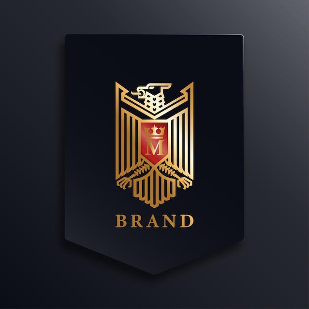 Golden eagle logo Vettore Premium