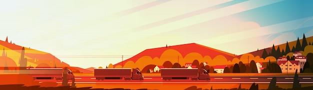 Grandi rimorchi del camion dei semi che guidano strada sopra le montagne abbelliscono al banner orizzontale del tramonto Vettore Premium