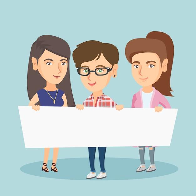 Gruppo di giovani donne che tengono un bordo in bianco bianco. Vettore Premium