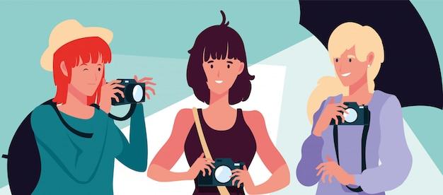 Gruppo di persone con le macchine fotografiche nello studio fotografico Vettore Premium