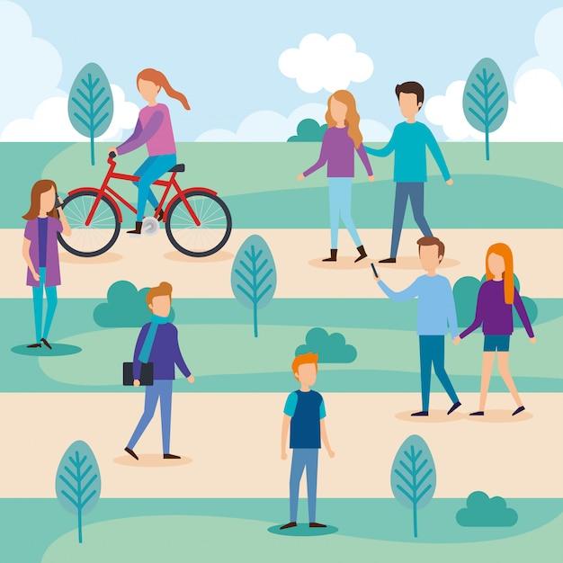 Gruppo di persone sul parco Vettore gratuito