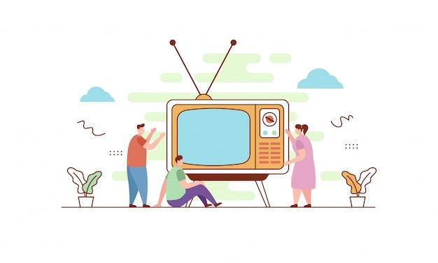 Guardare la tv retrò in stile piatto Vettore Premium