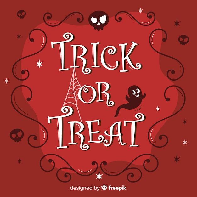 Halloween dolcetto o scherzetto calligrafia Vettore gratuito