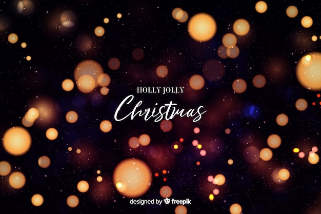 Holly jolly christmas bokeh background Vettore gratuito