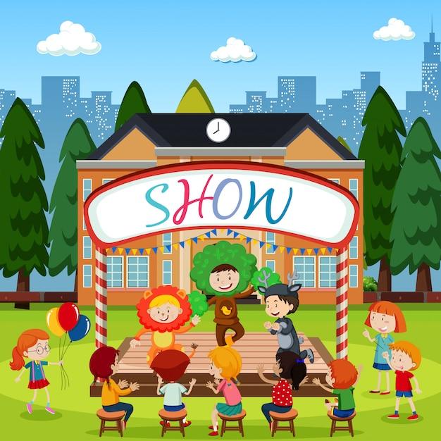 I bambini si esibiscono sul palco Vettore Premium