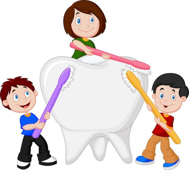 I bambini si lavano i denti bianchi Vettore Premium