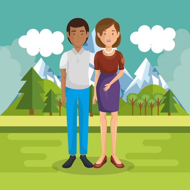 I genitori si accoppiano fuori nel paesaggio Vettore gratuito