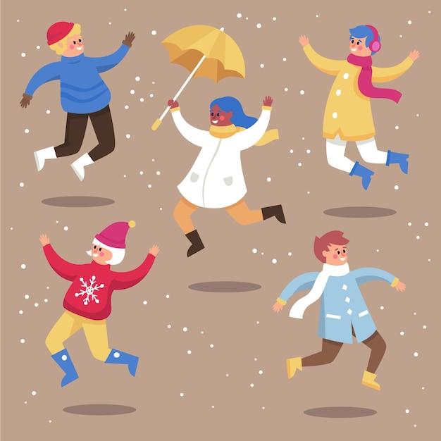 I giovani che indossano abiti invernali che salta insieme Vettore gratuito
