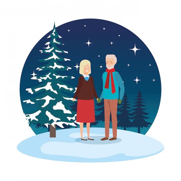 I nonni si accoppiano con i vestiti dell'inverno in snowscape Vettore Premium