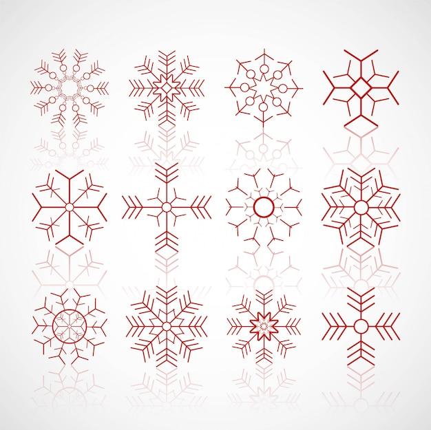 I vari fiocchi di neve dell'inverno hanno fissato il vettore di progettazione Vettore gratuito