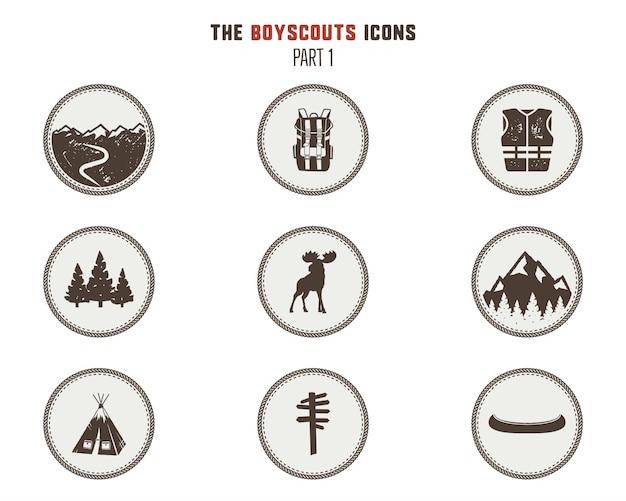 Icone di boy scout, patch. adesivi da campeggio simbolo della tenda, pittogramma delle alci, elementi dello zaino, canoa e altri. Vettore Premium