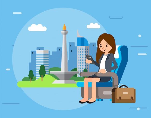 Il carattere delle donne di affari si siede sul sedile dell'aeroplano e sul controllo dello smartphone, della cartella accanto a lei e della città di jakarta come illustrazione Vettore Premium