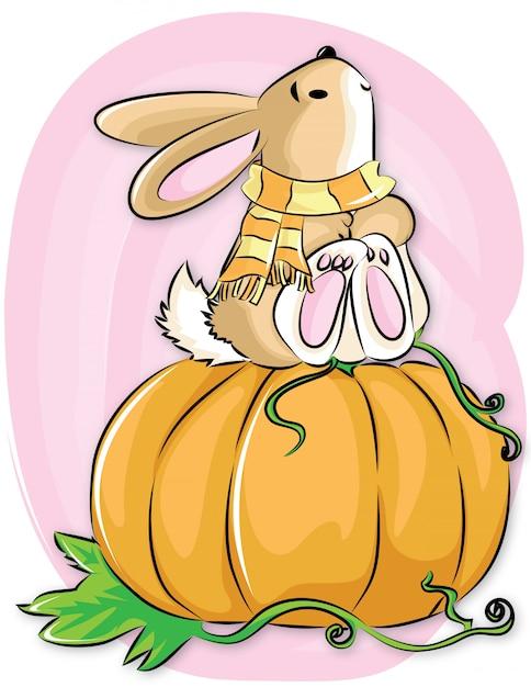 Il coniglio con l'abete si siede sui pumkins Vettore Premium