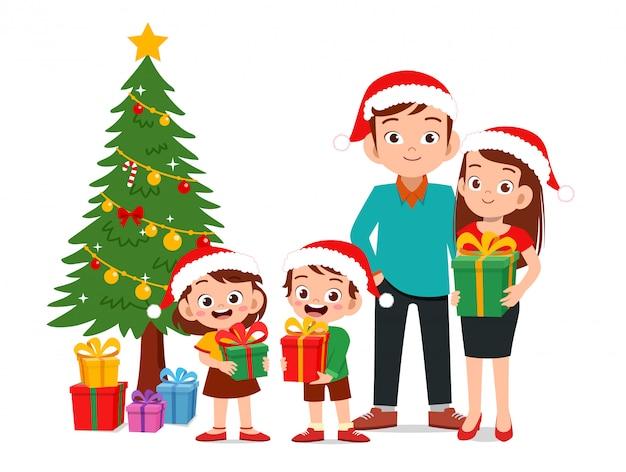 Il genitore felice dà il regalo a natale del bambino Vettore Premium
