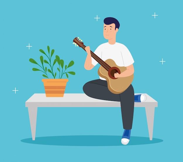 Il giovane resta a casa suonando la chitarra in tavola Vettore gratuito