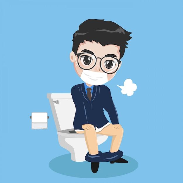 Il giovane uomo d'affari sta sedendosi nella toilette. Vettore Premium