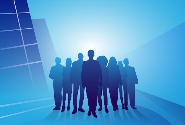 Il gruppo di gente di affari della siluetta della gente progetta sopra fondo astratto Vettore Premium
