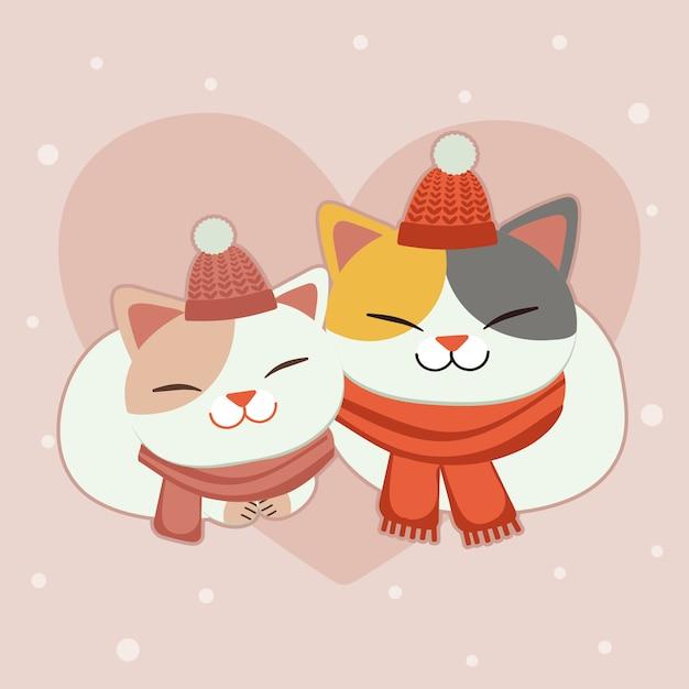 Il personaggio del simpatico gatto indossa una sciarpa e un cappello invernale sullo sfondo rosa con il cuore Vettore Premium