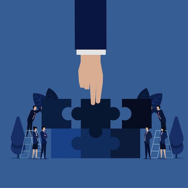 Il pezzo della squadra di puzzle della stretta della mano di affari si unisce per abbinare la metafora di puzzle di cooperazione e lavoro di squadra. Vettore Premium