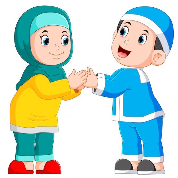Il ragazzo e la ragazza stanno dando il saluto a ied mubarak Vettore Premium