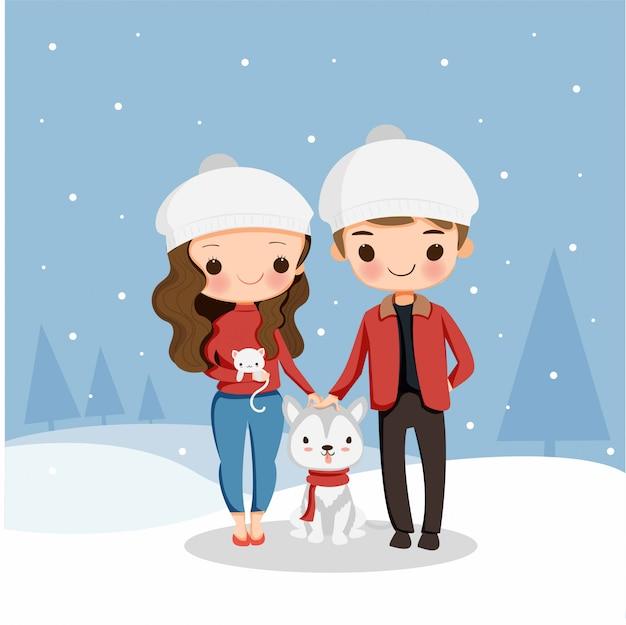 Il ragazzo e la ragazza svegli con il cane e il gatto godono di di giocare a neve sulla festa di natale Vettore Premium