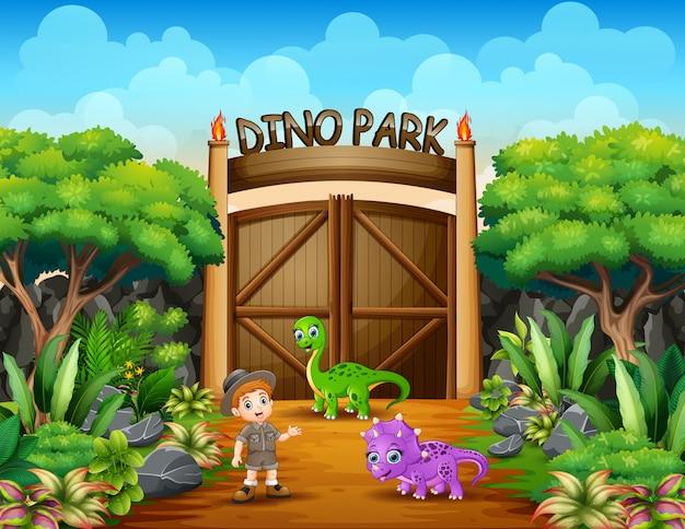 Il ragazzo esploratore nel parco di dino Vettore Premium
